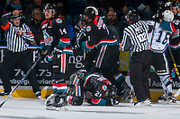 KELOWNA, CANADA - OCTOBER 26: Devante Stephens #21 of the Kelowna Rockets remains on the ice after a high stick by the Victoria Royals on October 26, 2016 at Prospera Place in Kelowna, British Columbia, Canada.  (Photo by Marissa Baecker/Shoot the Breeze)  *** Local Caption ***