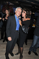 JOAN COLLINS and NICKOLAS GRACE at a party to celebrate the publication of her  autobiography - The World According to Joan, held at the British Film Institute, South Bank, London SE1 on 8th September 2011.