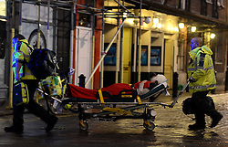 An  injured theatre goer is rushed away by Ambulance medics as Balcony Collapses at the Apollo Theatre in the West End, London, United Kingdom. Thursday, 19th December 2013. Picture by Peter Kollanyi / i-Images<br />