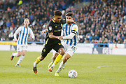Ollie Watkins of Brentford goes past Christopher Schindler of Huddersfield Town  during the EFL Sky Bet Championship match between Huddersfield Town and Brentford at the John Smiths Stadium, Huddersfield, England on 18 January 2020.