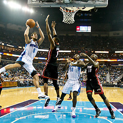November 5, 2010; New Orleans, LA, USA; New Orleans Hornets shooting guard Marco Belinelli (8) of Italy shoots over Miami Heat power forward Chris Bosh (1) during the first half at the New Orleans Arena. Mandatory Credit: Derick E. Hingle