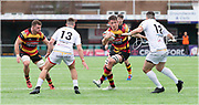 Carmarthen Quins' second row Josh Helps looks to avoid the tackle of Merthyr's centre Arron Pinches (12) and Harri Millard.<br /> <br /> Photographer: Dan Minto<br /> <br /> Indigo Welsh Premiership Rugby - Round 11- Merthyr RFC v Carmarthen Quins RFC - Saturday 21st December 2019 - Y Wern, Merthyr, South Wales, UK.<br /> <br /> World Copyright © Dan Minto Photography<br /> <br /> mail@danmintophotography.com <br /> www.danmintophotography.com
