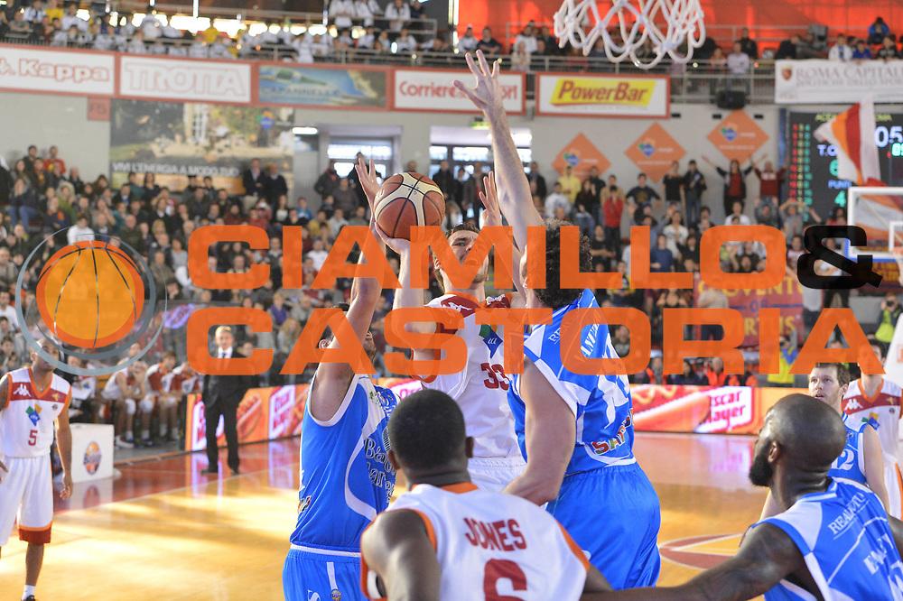 DESCRIZIONE : Roma Lega A 2012-13 Acea Roma Banco di Sardegna Sassari<br /> GIOCATORE : Olek Czyz<br /> CATEGORIA : tiro <br /> SQUADRA : Acea Roma<br /> EVENTO : Campionato Lega A 2012-2013 <br /> GARA : Acea Roma Banco di Sardegna Sassari<br /> DATA : 23/12/2012<br /> SPORT : Pallacanestro <br /> AUTORE : Agenzia Ciamillo-Castoria/GiulioCiamillo<br /> Galleria : Lega Basket A 2012-2013  <br /> Fotonotizia :  Roma Lega A 2012-13 Acea Roma Banco di Sardegna Sassari<br /> Predefinita :
