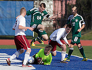 Middletown, New York - Chazy's Brandon Laurin (24) leaps over Fort Ann goalie Jonah Gould during the Class D state championship boys' soccer game at Faller Field in Middletown on Sunday, Nov. 18, 2012. Fort Ann's Garrett Bailey is at left, and his teammate Patrick Strainer is on the other side of Laurin.