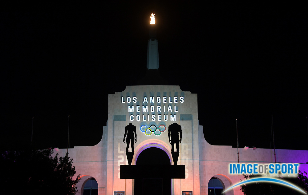 Sep 13, 2017; Los Angeles, CA, USA; General overall view of the Los Angeles Memorial Coliseum and Olympic torch illuminated in the colors of the LA2028 logo to commemorate the awarding of the 2028 Olympics and Paralympics to Los Angeles. Mandatory Credit: Kirby Lee-USA TODAY Sports