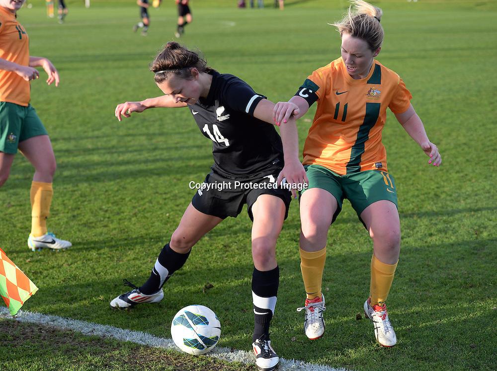 Meikayla Moore and Australia's Britt Whitfield. Junior Football Ferns v Young Matildas. Kristin School, Albany. Thursday 25 July 2013. Photo: Andrew Cornaga/Photosport.co.nz