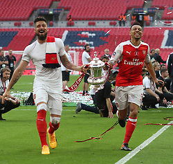 27 May 2017 - Then FA Cup Final - Arsenal v Chelsea - Olivier Giroud and Francis Coquelin of Arsenal celebrate with the trophy  - Photo: Mark Leech / Offside.
