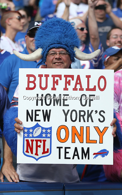 A Buffalo Bills fan holds up a sign referencing the fact that the Bills are the only NFL team actually based in New York State during the Buffalo Bills 2015 NFL week 4 regular season football game against the New York Giants on Sunday, Oct. 4, 2015 in Orchard Park, N.Y. The Giants won the game 24-10. (©Paul Anthony Spinelli)