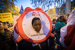 6 December 2019, Madrid, Spain: A woman dressed in a giant alarm bell suit 'sounds the alarm for climate justice', as faith-based participants from the Lutheran World Federation, the World Council of Churches and the ACT Alliance join in as thousands upon thousands of people march through the streets of central Madrid as part of a public contribution to the United Nations climate meeting COP25, urging decision-makers to take action for climate justice.