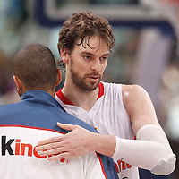 15 July 2012: Nicolas Batum of Team France is congratulated by Pau Gasol during a pre-Olympic exhibition game won 75-70 by Spain over France, at the Palais Omnisports de Paris Bercy, in Paris, France.