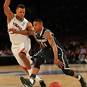 Keith Appling, Michigan State, in action during the Virginia Cavaliers Vs Michigan State Spartans basketball game during the 2014 NCAA Division 1 Men's Basketball Championship, East Regional at Madison Square Garden, New York, USA. 28th March 2014. Photo Tim Clayton