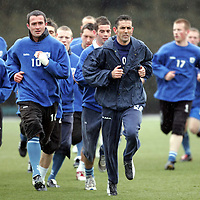 New St Johnstone manager Owen Coyle who took charge of the team today (Monday 18.04.05) running alongside club captain David Hannah during his first training session with his new players.<br />see story by Gordon Bannerman Tel: 01738 553978 or 07729 865788<br />Picture by Graeme Hart.<br />Copyright Perthshire Picture Agency<br />Tel: 01738 623350  Mobile: 07990 594431