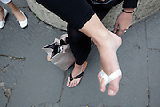 woman using first aid to protect foot skin from rubbing through