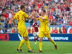 CHARLOTTE, USA - Saturday, August 2, 2014: Liverpool's Joe Allen scores the first goal against AC Milan with team-mate Rickie Lambert during the International Champions Cup Group B match at the Bank of America Stadium on day thirteen of the club's USA Tour. (Pic by David Rawcliffe/Propaganda)