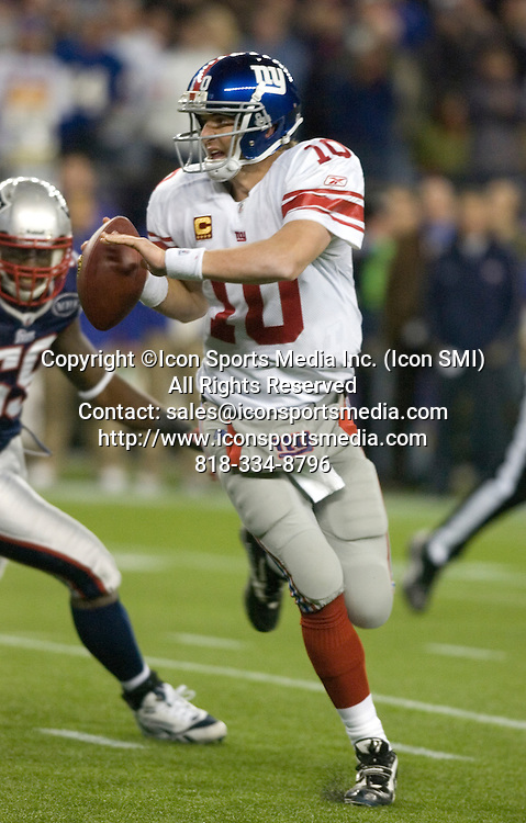 6 November 2011.   Giants Quarterback Eli Manning (10) on the run in the fourth quarter on a game winning drive. The New York Giants beat the New England Patriots 24 to 20 in Gillette Stadium in Foxboro on a Sunday afternoon game.