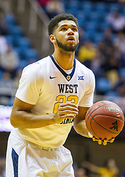 Nov 28, 2016; Morgantown, WV, USA; West Virginia Mountaineers forward Esa Ahmad (23) shoots a foul shot during the first half against the Manhattan Jaspers at WVU Coliseum. Mandatory Credit: Ben Queen-USA TODAY Sports