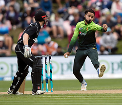 Pakistan's Faheem Ashraf, right, bowls a delivery as New Zealand's Kane Williamson looks to back upin the third one day cricket international at the University of Otago Oval, Dunedin, New Zealand, Saturday, January 13, 2018. Credit:SNPA / Adam Binns ** NO ARCHIVING**