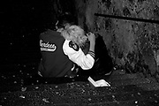 A drunk couple sat in the street, Aberdeen, Scotland, 2005