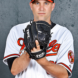 February 26, 2011; Sarasota, FL, USA; Baltimore Orioles starting pitcher Brad Bergesen (35) poses during photo day at Ed Smith Stadium.  Mandatory Credit: Derick E. Hingle
