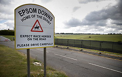 © Licensed to London News Pictures. 03/07/2020. Epsom, UK. A security fence surrounds Epsom Racecourse in Surrey ahead of the running of The Derby. Tomorrow's race meeting is being held behind closed doors due to the coronavirus lockdown rules. Seven races are being held in one day including The Oaks, with The Derby being run at 17:30pm. Photo credit: Peter Macdiarmid/LNP