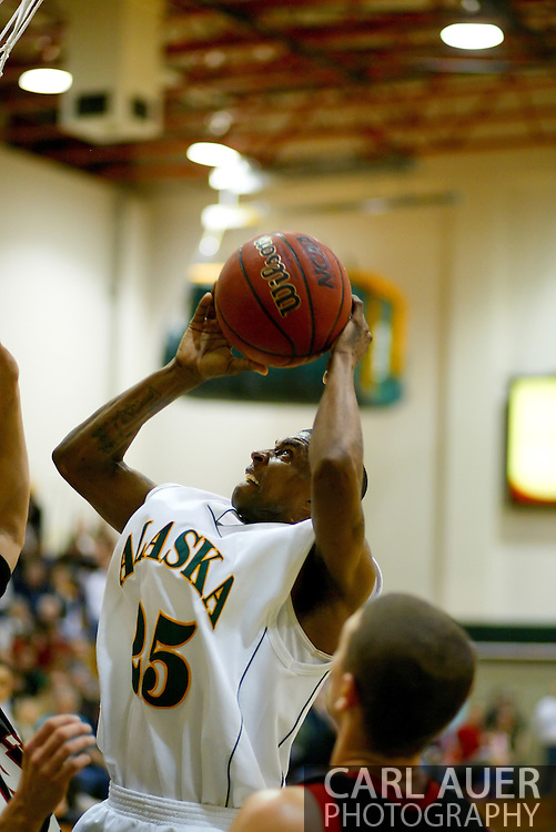 1/13/2006: Senior guard Eric Draper (25) of the UAA Seawolves takes a shot in the Alaska Anchorage comeback victory over Northwest Nazarene, 60-57, in men?s basketball action at the Wells Fargo Sports Complex on Saturday.