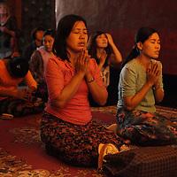 Buddhist pilgrims pray in Bagan's beautiful Ananda Pagoda.