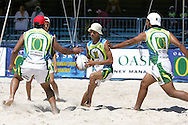 Camps Bay, A player is caught on both sides during the Oasis SKW Camps Bay Beach Touch Rugby Tournament held on the 2 February 2008, Cape Town, South Africa...Image © Sportzpics