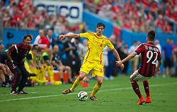 CHARLOTTE, USA - Saturday, August 2, 2014: Liverpool's Martin Kelly in action against AC Milan during the International Champions Cup Group B match at the Bank of America Stadium on day thirteen of the club's USA Tour. (Pic by David Rawcliffe/Propaganda)