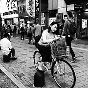 TOKYO, JAPAN - OCTOBER 20 : A woman using her mobile phone in Kabukicho, Shinjuku district Tokyo, Japan on October 20, 2015. <br /> <br /> Photo: Richard Atrero de Guzman