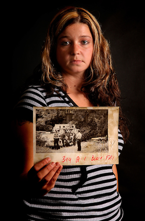 July 17 2007, Jason Miller ---  Nichole Smith holds a photo from the Chronicle-Telegram archives from 1990 when her best friend Angela Hicks was murdered in Elyria. No one was ever arrested in Hicks murder which is why 17 years later, Smith is asking that the case be reinvestigated using modern forensics techniques.