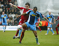 Photo: Chris Ratcliffe.<br />Leyton Orient v Wycombe Wanderers. Coca Cola League 2. 25/03/2006.<br />Wycombe player Kevin Betsy tussles with John Mackie of Leyton Orient