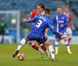 Bristol City's Luke Ayling is tackled by Gillingham's Joe Martin - Photo mandatory by-line: Dougie Allward/JMP - Mobile: 07966 386802 - 08/11/2014 - SPORT - Football - Gillingham - Priestfield Stadium - Gillingham v Bristol City - FA Cup - Round One