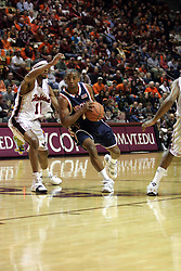 J. R. Reynolds (2) drives against the Hokie defense.  Reynolds had 16 points on the game to help lead the Hoos to a 54-49 victory in Blacksburg.