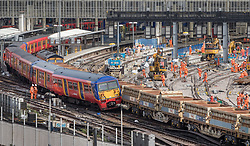 © Licensed to London News Pictures. 15/08/2017. London, UK. A derailed train rests on wagons of a freight train at Waterloo station in London after a low speed collision. People have been advised to avoid using Waterloo station, which is undergoing major development works (R), for the remainder of the day.  Photo credit: Peter Macdiarmid/LNP