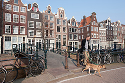 Traditional historic Dutch gable houses beside Brouwersgracht canal in Amsterdam The Netherlands