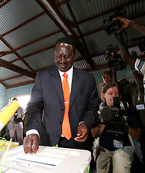 Presidential candidate of Coalition for Reform and Democracy (CORD) Raila Odinga (R, front) casts his ballot at a polling station in Nairobi, Kenya, March 4, 2013. A total of 14.3 million Kenyan voters lined up to cast their ballots Monday morning to choose the country s next president, the first after disputed presidential elections tally stirred up violence five years ago, Monday March 4, 2013. Photo by Imago / i-Images...UK ONLY