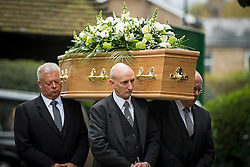 © Licensed to London News Pictures. 18/04/2016. Shirley, UK.  The coffin arrives at The funeral of comedian, actor, writer Ronnie Corbett, held at St John the Evangelist Church in Shirley near Croydon. Corbett, who was most famous for his comedy sketch show  The Two Ronnies, performed with the late Ronnie Barker, died at the age of 85. Photo credit: Ben Cawthra/LNP