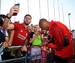 BLACKBURN, ENGLAND - Thursday, July 19, 2018: Liverpool's Fabio Henrique Tavares 'Fabinho' signs autographs for supporters as he arrives at the stadium before a preseason friendly match between Blackburn Rovers FC and Liverpool FC at Ewood Park. (Pic by Paul Greenwood/Propaganda)