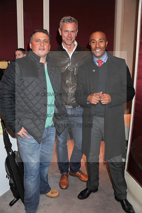 Left to right, DARREN GOUGH, MARK FOSTER and COLIN JACKSON at a reception to unveil the ISAF World Match Racing Tour Championship Trophy at Garrard, 24 Albemarle Street, London W1 on 7th November 2011.