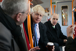 Boris Johnson drinks coffee inside the tube to Waterloo with representatives of TLF and rail network. -Person on the right Andrew Adonis is a British Labour Party politician, academic and journalist who served in the Labour Government for five years,  London, UK. 14th May, 2013. Photo by: Daniel Leal-Olivas / i-Images