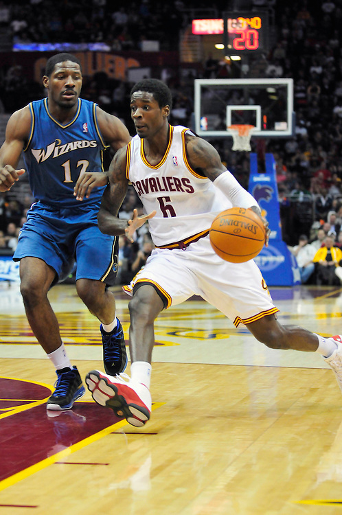 April 13, 2011; Cleveland, OH, USA; Cleveland Cavaliers guard Manny Harris (6) drives past Washington Wizards guard Othyus Jeffers (12) during the second quarter at Quicken Loans Arena. Mandatory Credit: Jason Miller-US PRESSWIRE