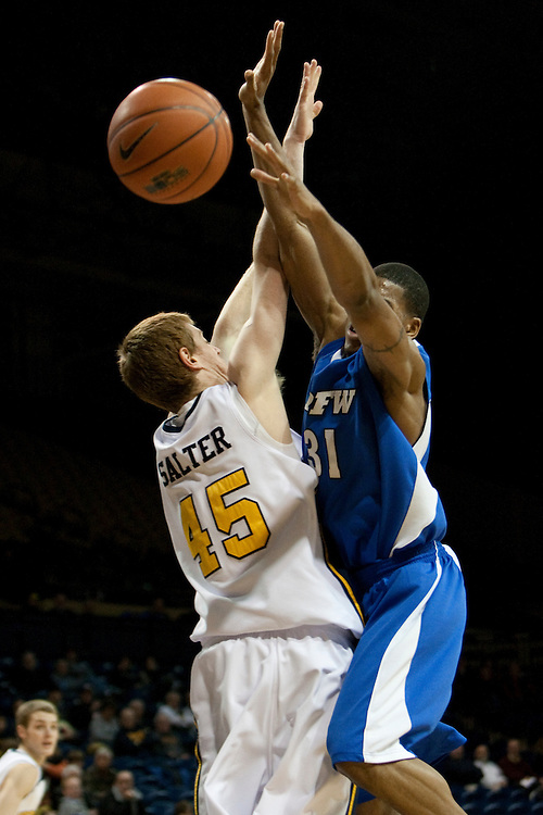 10 December 2009:  Toledo's Ian Salter and IPFW's Deilvez Yearby (31) during the NCAA basketball game between IPFW and the Toledo Rockets at Savage Arena in Toledo, OH.