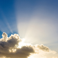 Beautiful sun rays behind the clouds / cl043