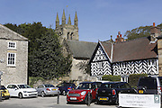 Cars are parked in Helmsley's town square, Yorkshire, England, United Kingdom.