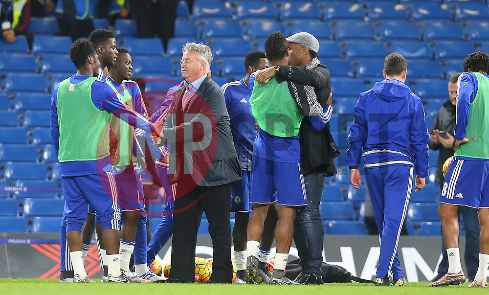 Newly appointed Chelsea Manager, Guus Hiddink ( 4th L ),  and Didier Drogba ( 3rd R ) shake hands with the players after the match  - Mandatory byline: Paul Terry/JMP - 07966 386802 - 19/12/2015 - FOOTBALL - Stamford Bridge - London, England - Chelsea v Sunderland - Barclays Premier League