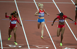 © Licensed to London News Pictures. 05/08/2012. London,UK.USA's Sanya Richards-Ross crosses the line in font of Russia's Antonina Krivoshapka and USA's DeeDee Trotter, to win gold in the Women's 400m, at the Olympic Stadium, in London, during the London 2012 Olympic Games. Photo credit : Bogdan Maran/LNP/BPA