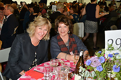 Left to right, ANNABEL ELLIOT and LADY ASHCOMBE at a lunch in aid of the charity African Solutions to African Problems (ASAP) held at the Louise T Blouin Foundation, 3 Olaf Street, London W11 on 21st May 2014.