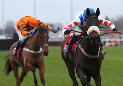 Clan Des Obeaux and Harry Cobden lead Thistlecrack and Tom Scudamore home to win The 32REd King George VI Steeple Chase Race run during day one of 32Red Winter Festival at Kempton Park Racecourse.