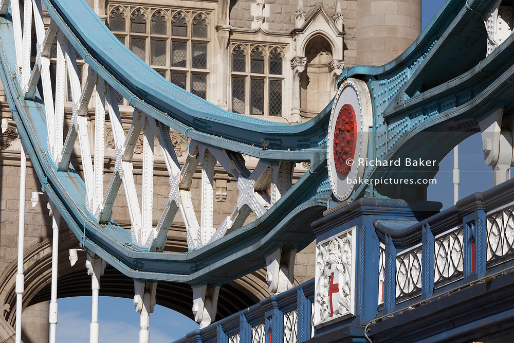 Detail of the southern end steel suspension chains and hangers plus the southern abutment tower of the Victorian-era Tower Bridge, on 27th September 2018, in London, England.