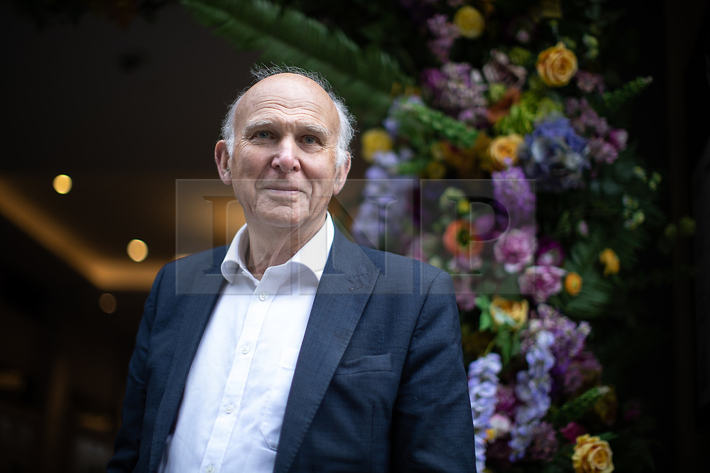 """© Licensed to London News Pictures. 20/06/2019. Manchester, UK. In one of his last actions as Liberal Democrat Party leader , SIR VINCE CABLE meets Big Issue sellers in Manchester City Centre , alongside Cllr John Leach and Jane Brophy MEP . The party say they are highlighting what they call a """" Homeless Tax """" , which they oppose , and which could see fines of up to £1,000 imposed upon the homeless by Manchester City Council . The final Local Government Information Unit (LGiU) report from the Local Government Homelessness Commission (LGHC) – a year-long initiative set up to investigate how councils can fulfil their obligation to prevent homelessness - is due to be published . The Liberal Democrats will appoint a new leader in July . Photo credit: Joel Goodman/LNP"""